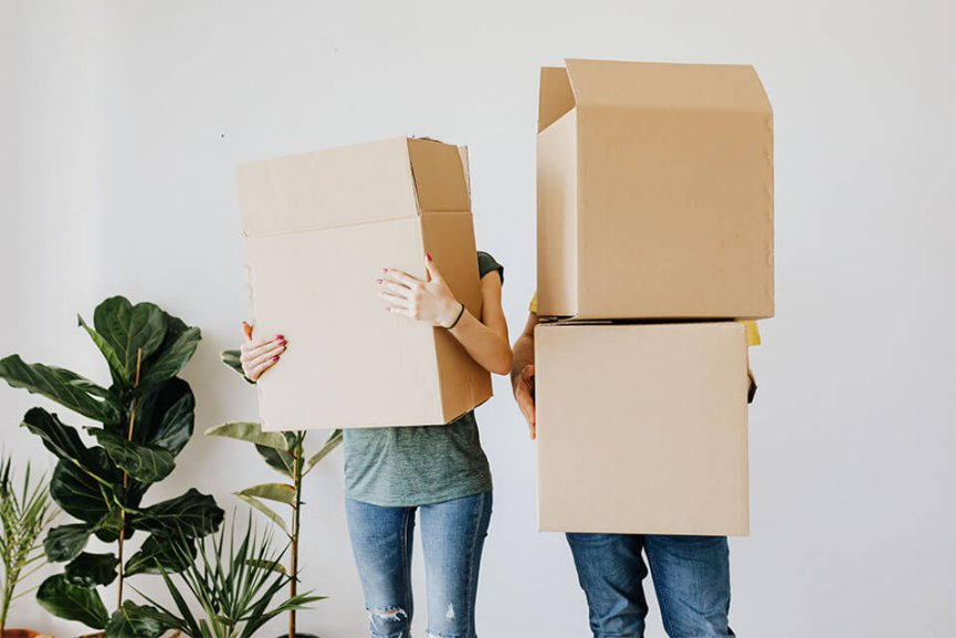 People holding moving boxes