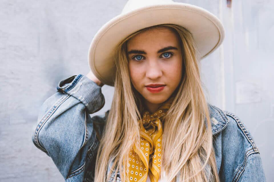 Blonde woman in hat