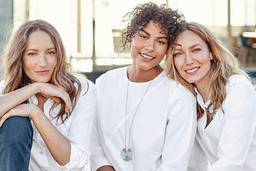 Women in white sweaters