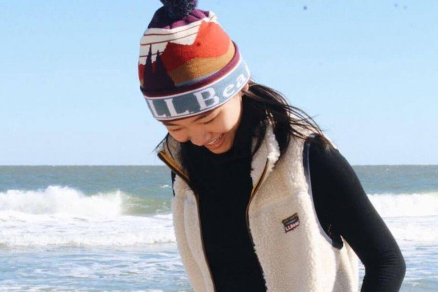 Woman on beach in beanie from L.L. Bean