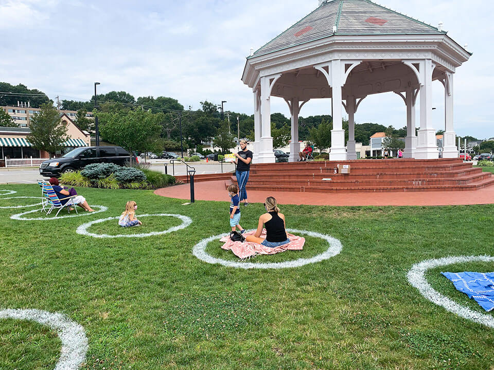 Socially distanced circles spray painted on the lawn at Garden City Center