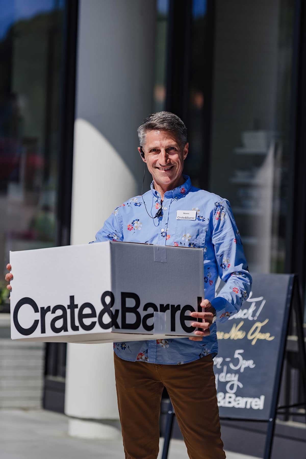 Employee outside of Crate & Barrel