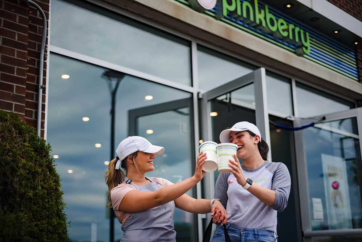 Employees outside of Pinkberry
