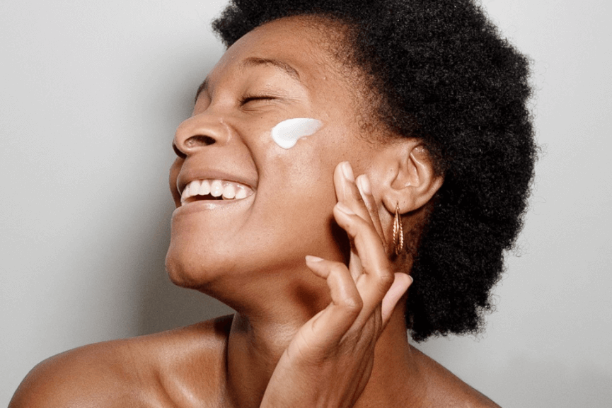 Photo of a woman applying skincare products